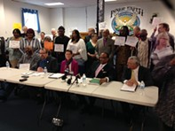 Coalition members Ted Forsyth (left), Barbara Lacker-Ware, Rev. Lewis Stewart, and attorney Charles Burkwit. - FILE PHOTO