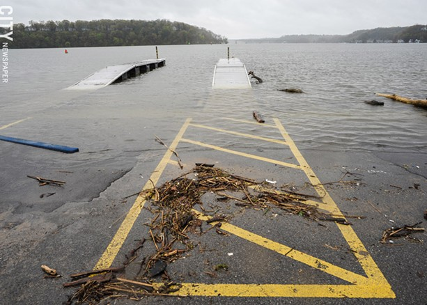 The Irondequoit Bay Marine Park's boat launch has been submerged in the rising water. - PHOTO BY JEREMY MOULE