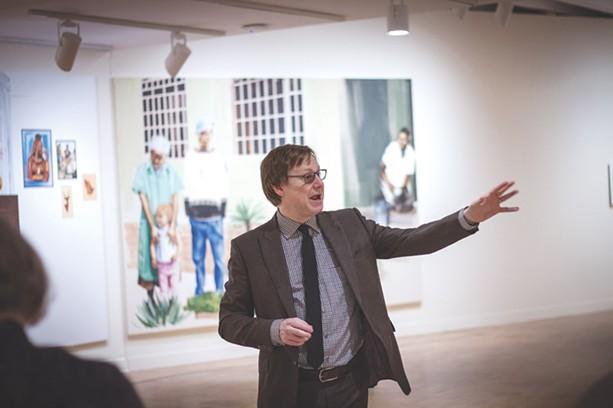 MAG Director Jonathan Binstock at the gallery's Meleko Mokgosi exhibit. - PHOTO BY KEVIN FULLER