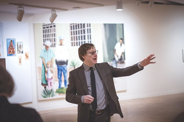 MAG Director Jonathan Binstock at the gallery's Meleko Mokgosi exhibit. - PHOTO BY KEVIN FULLER