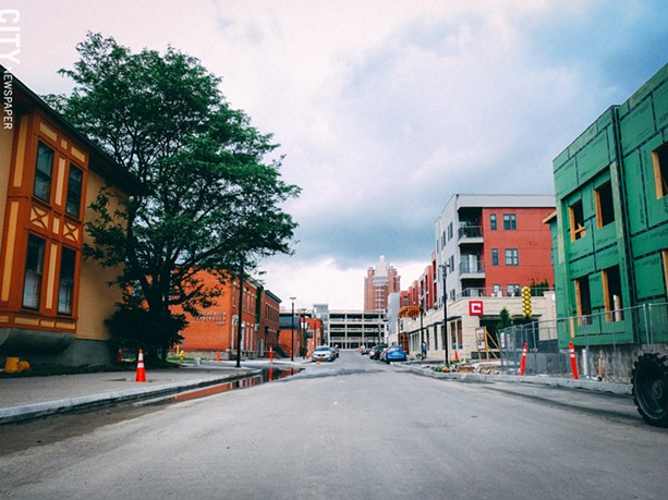 Charlotte Street, which used to be split by the Inner Loop, now connects downtown to the University-East Avenue neighborhood to the east. Above: the new Charlotte Square residential complex on the west side of the Loop infill. - PHOTO BY KEVIN FULLER