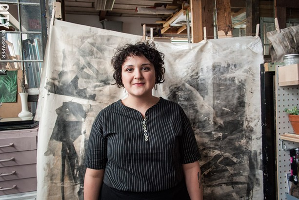 Rebecca Lomuto in her studio at The Yards, in front of one of her photographic installations. - PHOTO BY RYAN WILLIAMSON