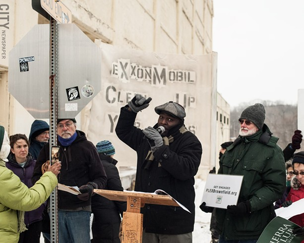 PLEX Neighborhood Association Vice President Dorian Hall calls for the properties in the Vacuum Oil Brownfield Opportunity Area to be thoroughly cleaned up. - PHOTO BY JEREMY MOULE