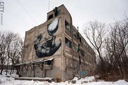 The former Vacuum Oil refinery on Flint Street, right next to the Genesee River, sits on land contaminated with petroleum and refining-related chemicals. - PHOTO BY JEREMY MOULE