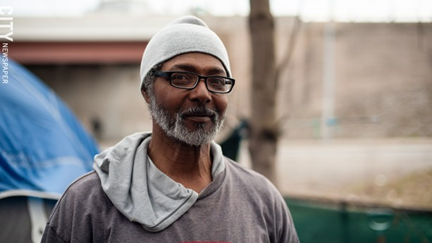Geneo Brown has lived in the tent city at the edge of Spectrum's property for around two years. - PHOTO BY JEREMY MOULE