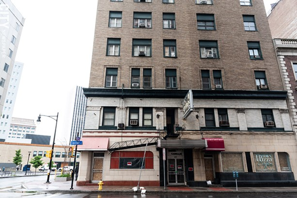 The Hotel Cadillac's owner has secured doors and windows on the building's first floor, and posted no trespassing signs. - PHOTO BY JEREMY MOULE