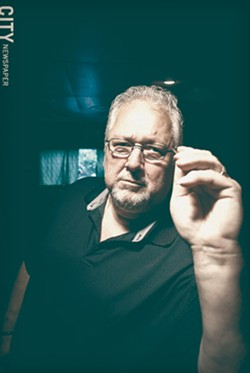 Nick Maguire has been playing darts at Casey Jones on Ridgeway Avenue since 1982. - PHOTO BY RYAN WILLIAMSON