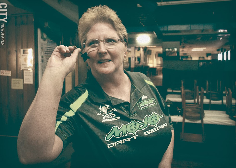 Amy DeBruyne is Rochester's top-ranked woman steel-tip darts player. - PHOTO BY RYAN WILLIAMSON