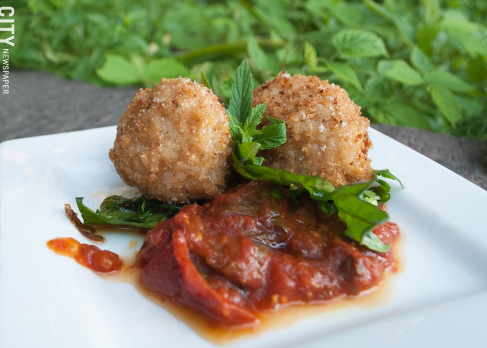 Crispy brown rice arancini stuffed with mozzarella and Gorgonzola. - PHOTO BY RYAN WILLIAMSON