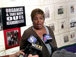 Lentory Johnson created The Mothers' Quilt showing Rochester youth killed though gun violence. - PHOTO BY TIM MACALUSO