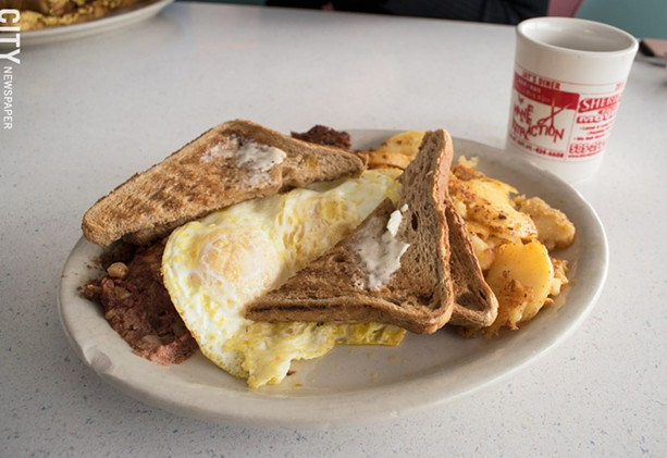 Served 24/7 at Jay's Diner: Corned beef hash with two eggs over easy, home fries, and wheat toast. - PHOTO BY JACOB WALSH