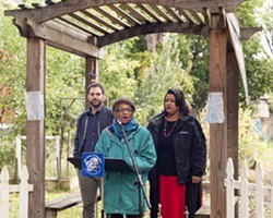 Ann Culbreth, co-manager of the South Wedge Victory Gardens, talks about the benefits of longer-term permits for community gardens. With her is City Council member Mitch Gruber, left, and City Department of Recreation and Youth Services CommissionerDaniele Lyman-Torres, right. - PHOTO BY JEREMY MOULE