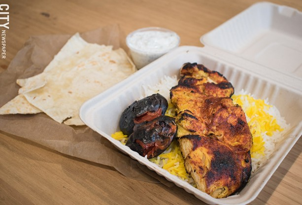Chortke's spicy joojeh plate features grilled chicken and tomato over saffron basmati rice. - PHOTO BY JACOB WALSH