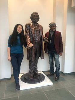 Artist Olivia Kim and Carvin Eison with one of Kim's statues of Frederick Douglass. Volunteers were an important factor in producing the sculptures. - PHOTO PROVIDED
