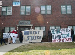 Tenants at 967 Chili Avenue during a rally last year to protest the poor conditions of their building. - FILE PHOTO