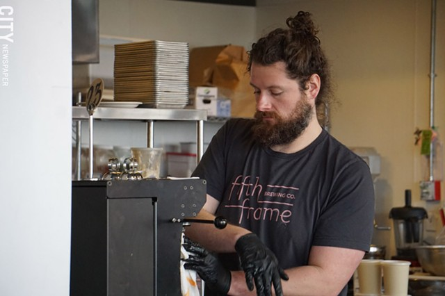 Fifth Frame's Jon Mervine filling a crowler on Friday, March 20.