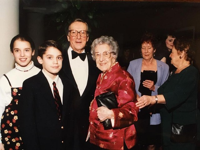 Bill Pearce, with children Tyler and Ryder and his mom, Mary Fitzgerald Pierce, at Bill's retirement dinner in 1995.