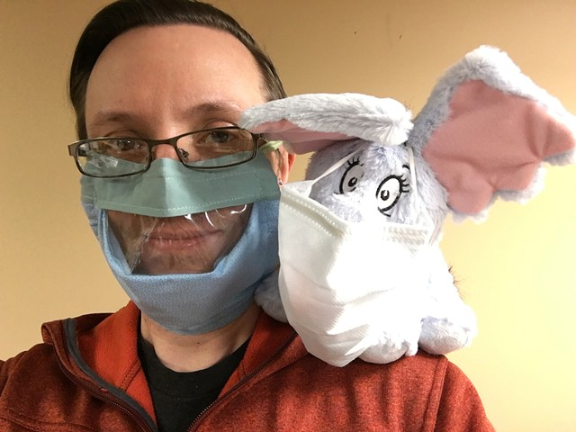 Dr. Gregory Horton of Rochester Hearing & Speech Center tests out a mask with a clear window, enabling clients who rely on lip-reading to see his mouth.