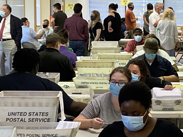 Monroe County Board of Elections workers count absentee ballots that were cast in the June 23, 2020, primary election.