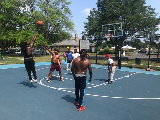 A pickup basketball game at Cobb's Hill Park on July 8, 2020, after the city replaced the rims it had taken down in March due to concerns about the spread of the novel coronavirus.