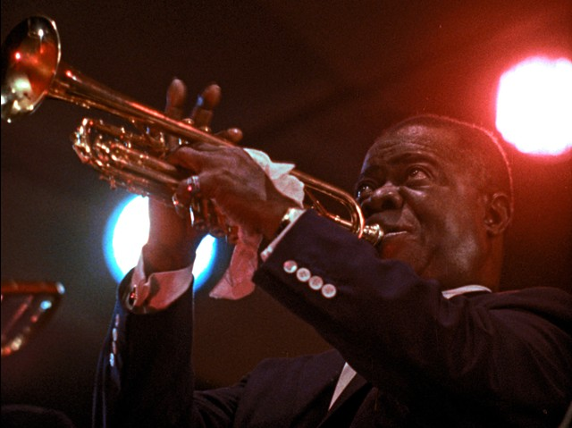 """Musician Louis Armstrong in a scene from the 1959 concert film """"Jazz on a Summer's Day,"""" now playing in the Virtual Little Theatre."""