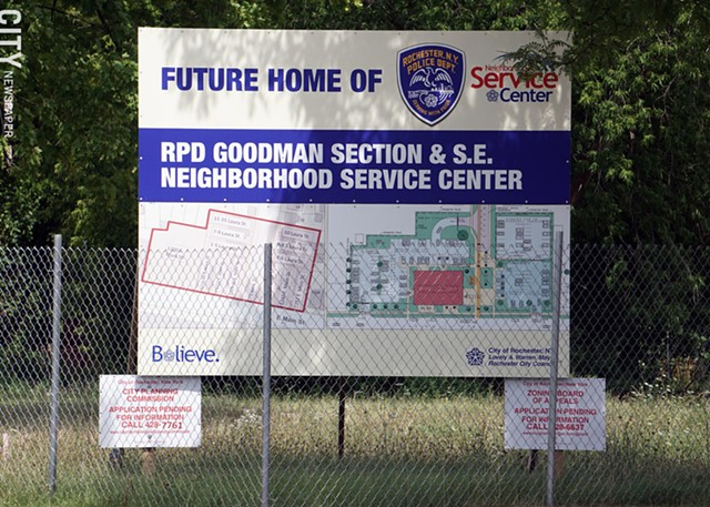 A sign marking the future location of the police station.
