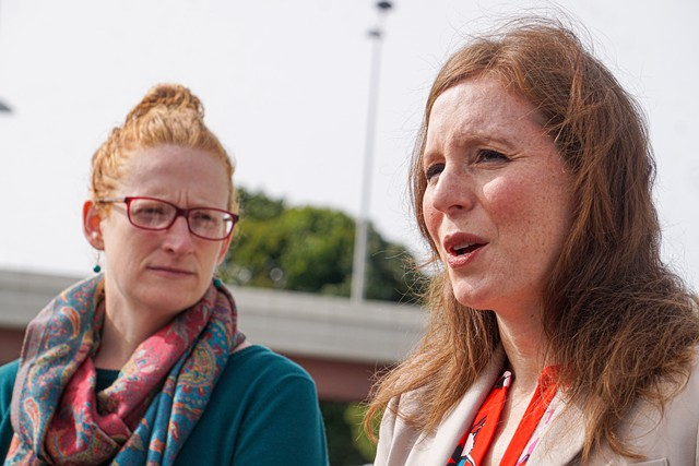 Councilmember Mary Lupien (left) and County Legislator Rachel Barnhart, speaking outside the Monroe County Public Safety Building.