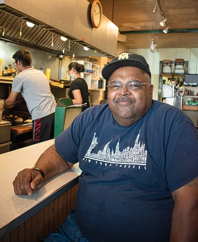 James Brown occupies his familiar spot at the lunch counter of his namesake diner, James Brown's Place.