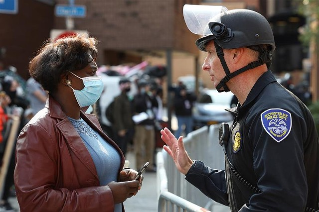 The Rev. Myra Brown of Spiritus Christi Church talks with Rochester Police Capt. Ray Dearcop outside City Hall during a protest in September 2020.