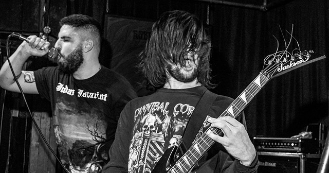 Vocalist Alex Jones and guitarist Kyle Beam performing in the death metal band Undeath