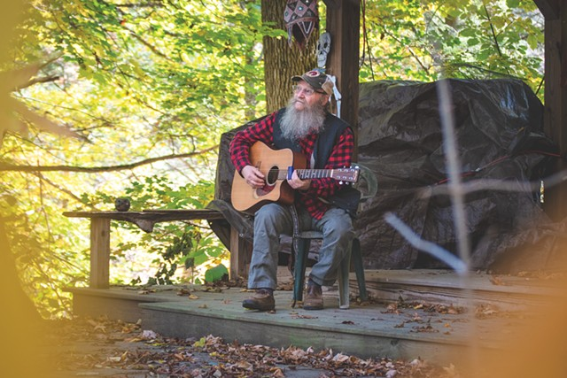 Bob Bunce plays guitar on one of the two stages he made himself on his rural property near Groveland, New York.