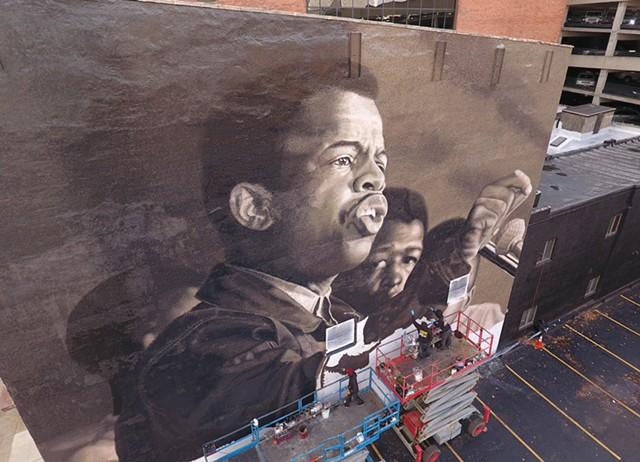 "Painters depict a young John Lewis in the mural ""I Am Speaking,"" at 49 State St. in downtown Rochester."