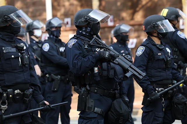 """Police converge on City Hall on Sept. 16, 2020, in response to demonstrators """"occupying"""" the exterior of the building."""