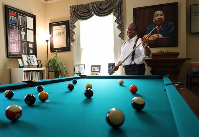 Van White plays pool on the table that Martin Luther King Jr. played on while a student at Crozer Theological Seminary. White had the pool table restored and placed it in a room in his law office dedicate to King's  legacy.