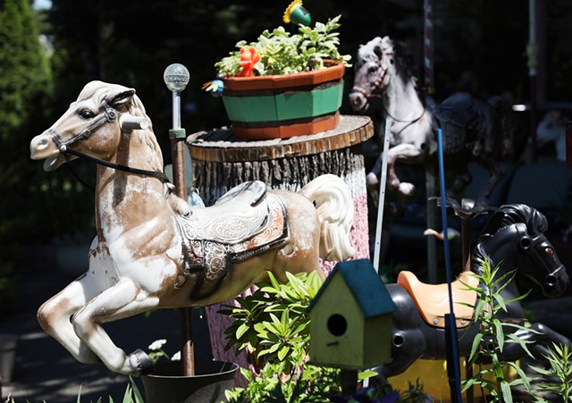 Most of the more than 120 horses in the Rodriguezes' yard at the corner of North and St. Jacob streets have been dismantled from their spring-based rockers and placed between flowers and trees.