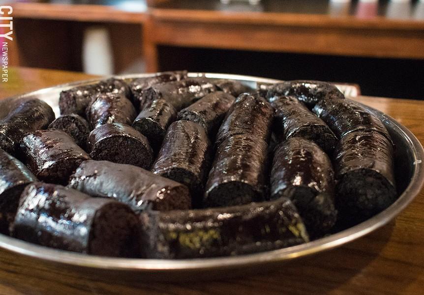 Morzillas AKA El Amor de las Nenas AKA Blood Sausages, a highly sought-after staple at El Cuchifrito. - PHOTO BY JACOB WALSH
