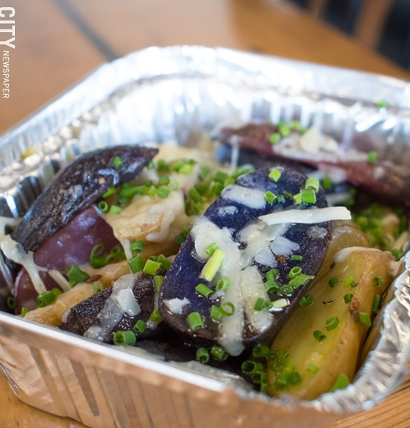 Tri-color fingerling potatoes with freshly-grated Parmesan, garlic, and chives. - PHOTO BY JACOB WALSH