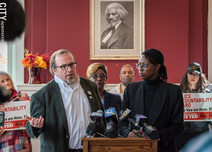 Police-oversight activists Ted Forsyth, left, and Stanley Martin, at a press conference last week urging passage of the Police Accountability Board referendum. - PHOTO BY RYAN WILLIAMSON
