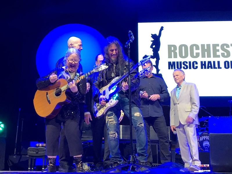 "Christine Lavin (front left) performing at the 2019 Rochester Music Hall of Fame Induction Ceremony last April with Ron ""Bumblefoot"" Thal (front right) and Al Jardine (far right). - PHOTO BY PETER PARTS"