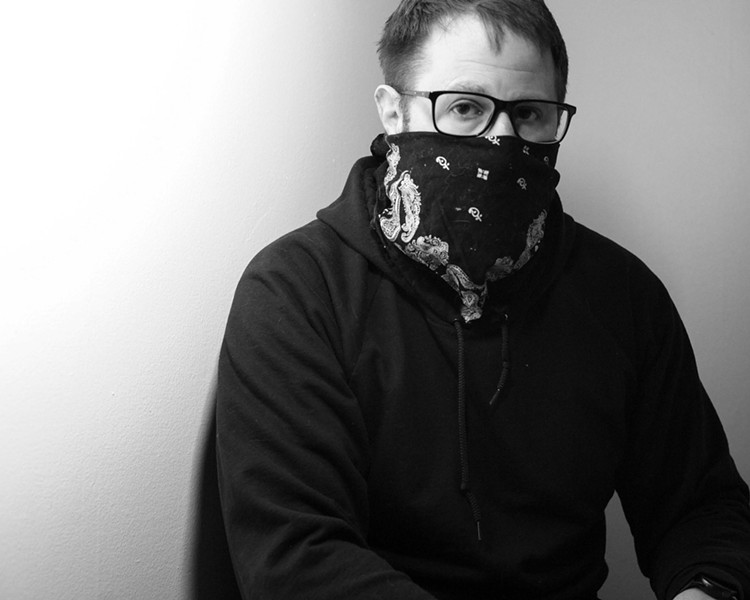 This is me, at home, trying to get used to having part of my face covered up. - PHOTO BY JEREMY MOULE