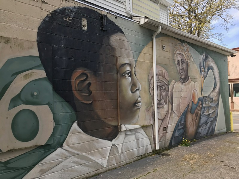 A mural on the exterior back wall of NEAD (North East Area Development) offices. - PHOTO BY DAVID ANDREATTA
