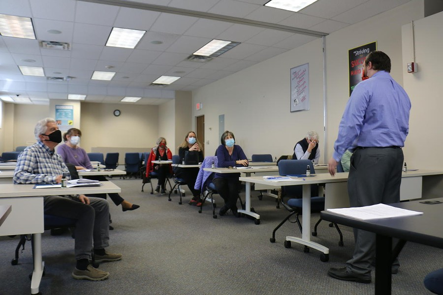 Aaron Cignarale trains a class of volunteer contact tracers at the Monroe County Public Health Department offices recently. - PHOTO BY BRETT DAHLBERG