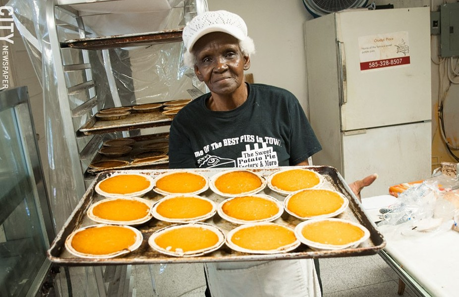 Alberta Jacque presents a tray of fresh pies at Sweet Potato Pie Factory & More. - FILE PHOTO