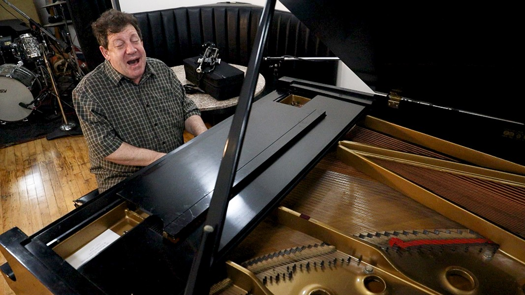 "Seiger plays trumpet and piano and sings like Louis Armstrong. ""I hope ... I can keep just a little bit of the joy he wanted to give the world,"" he says. - PHOTO BY MAX SCHULTE / WXXI NEWS"