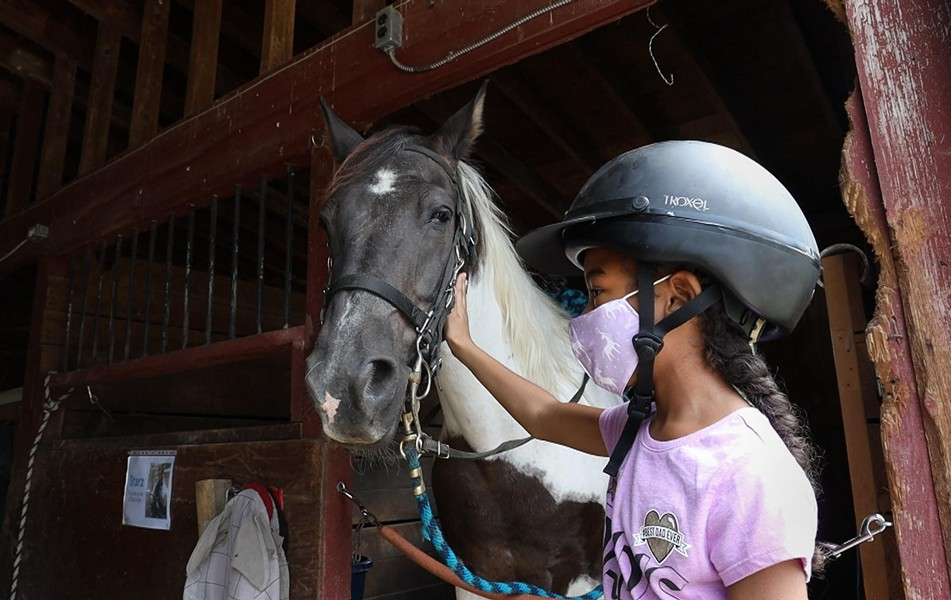 "Jayla Rogers, a 9-year-old who lives in Gates attended a one-week camp at A Horse's Friend this summer. ""She really enjoyed her time there and has a passion for animals, especially horses,"" says Jayla's mother, Sara Rogers. - PHOTO CREDIT MAX SCHULTE / WXXI NEWS"