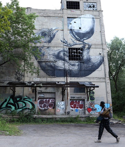 A former Vacuum Oil building sits vacant along the Genesee River at 5 Flint Street. - PHOTO BY MAX SCHULTE