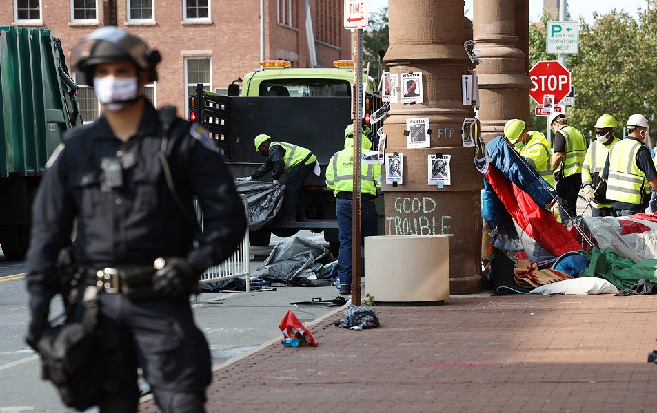A city crew clears away tents that protesters set up in front of City Hall. - PHOTO BY MAX SCHULTE