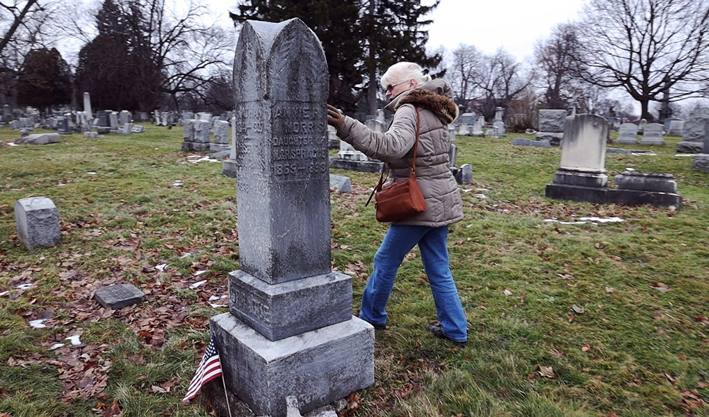 Marilyn Nolte, of the Friends of Mt. Hope Cemetery,  visits the Sprague family plot. - PHOTO BY MAX SCHULTE