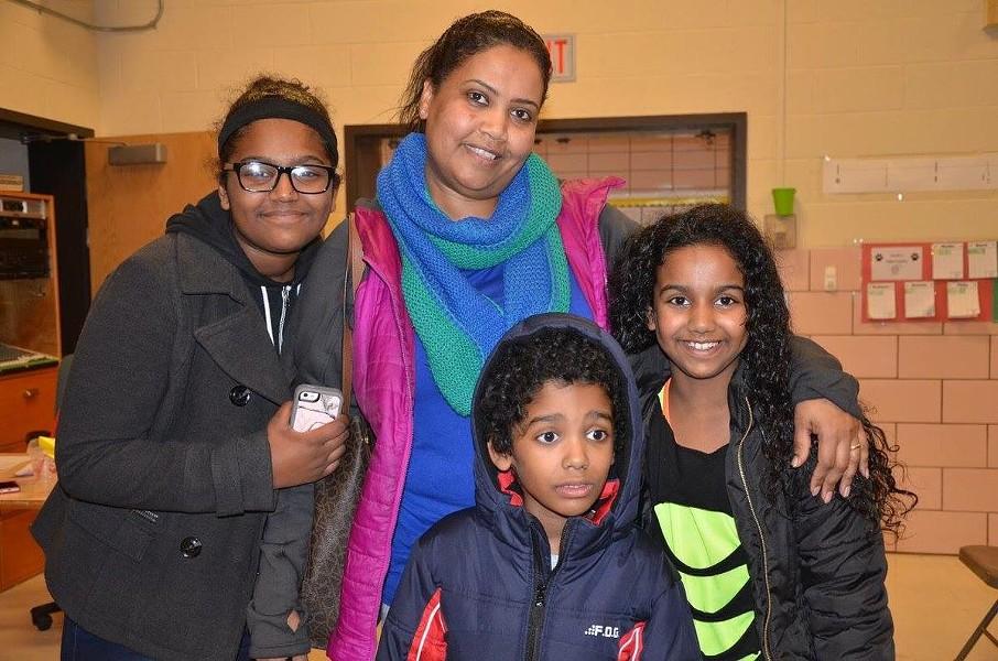 Mai Abdullah, center, and her three children. - PHOTO PROVIDED