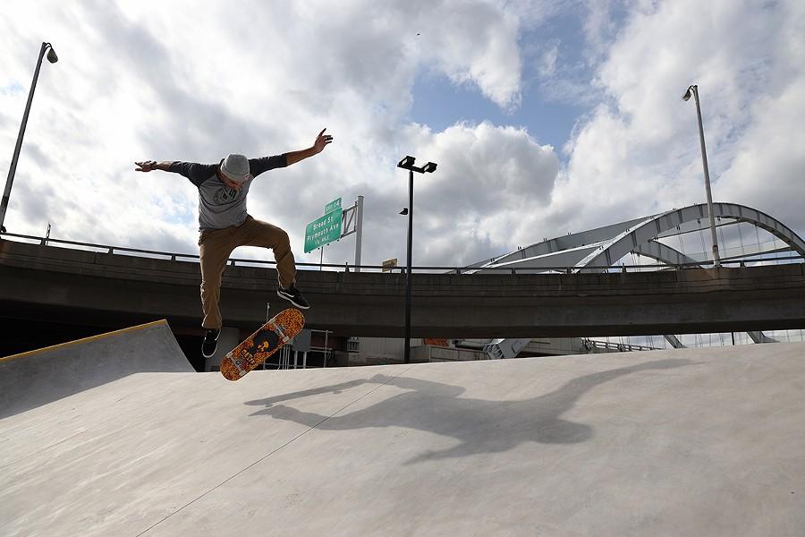Park designer Kanten Russell skating the Roc City Skatepark on Thursday, Oct. 15. - PHOTO BY MAX SCHULTE